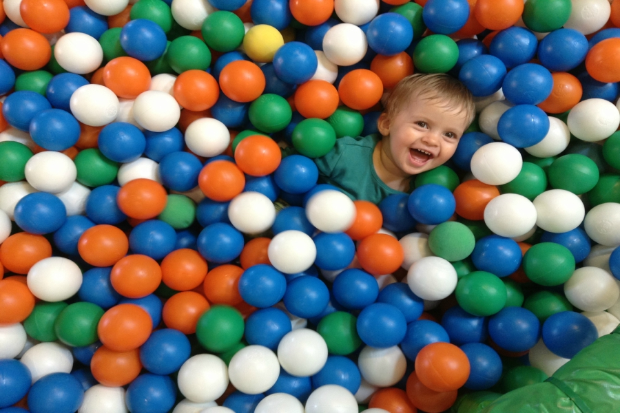 Smiling Child in Ball Pool